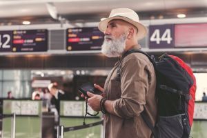 A man at a noisy airport.